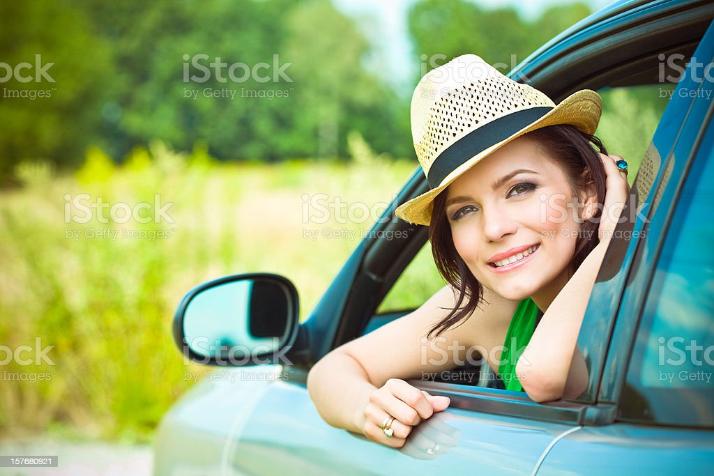 Beautiful woman in a car stock photo