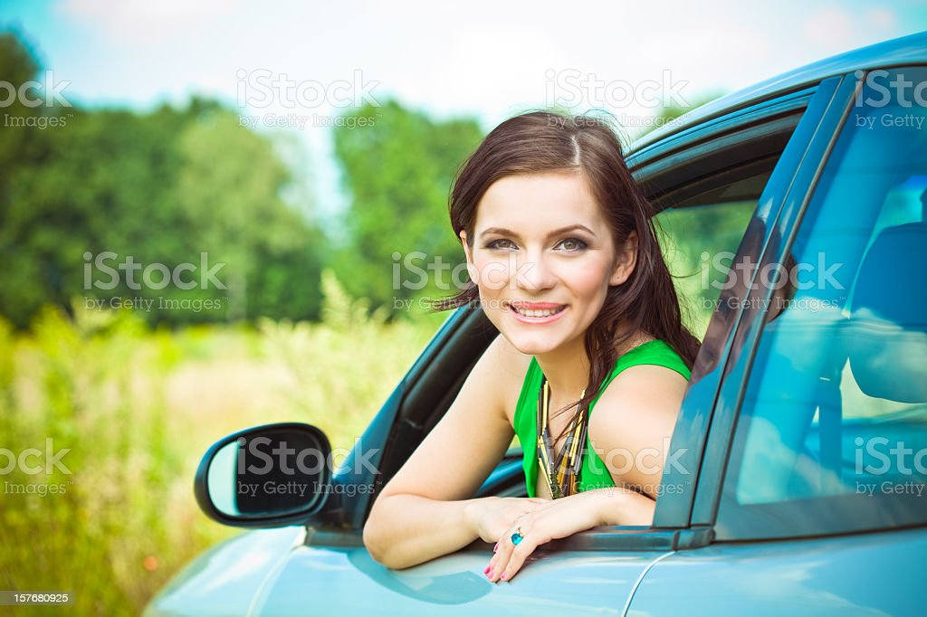 Beautiful woman in a car royalty-free stock photo