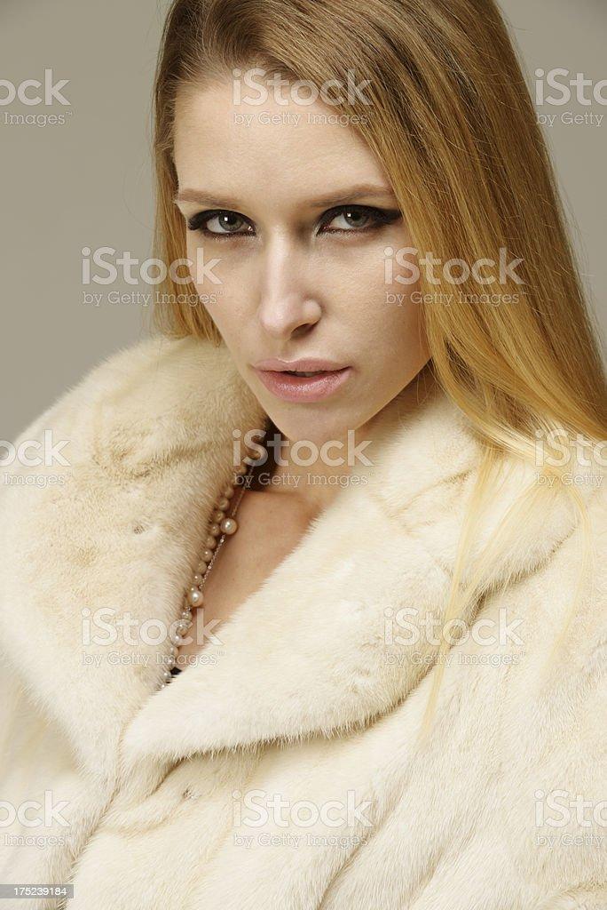 Beautiful woman in a fur coat stock photo