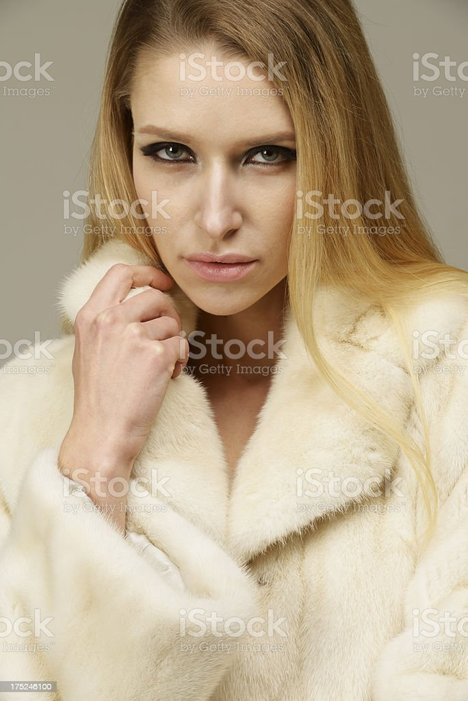 Beautiful woman in a fur coat stock photo