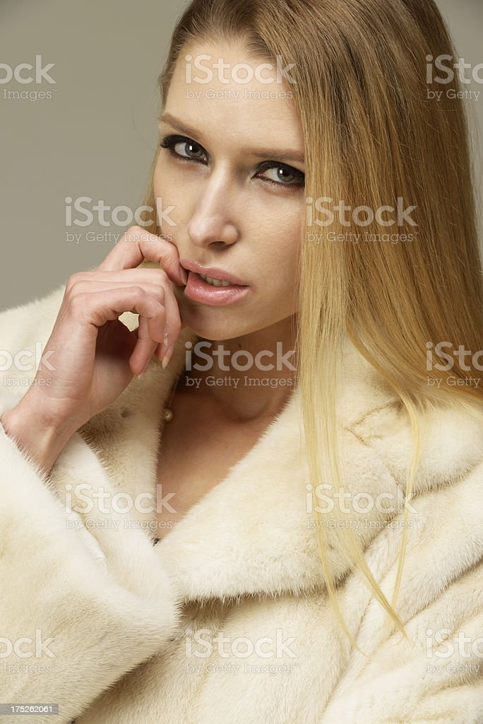 Beautiful woman in a fur coat royalty-free stock photo