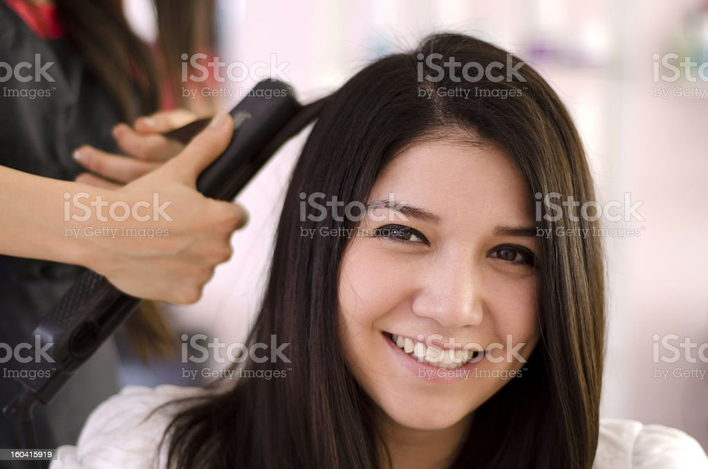 Beautiful woman in a hair salon royalty-free stock photo