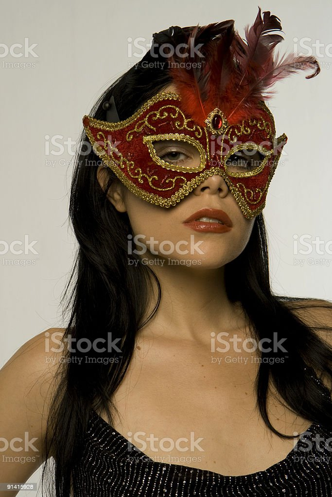 Beautiful woman in a mask royalty-free stock photo