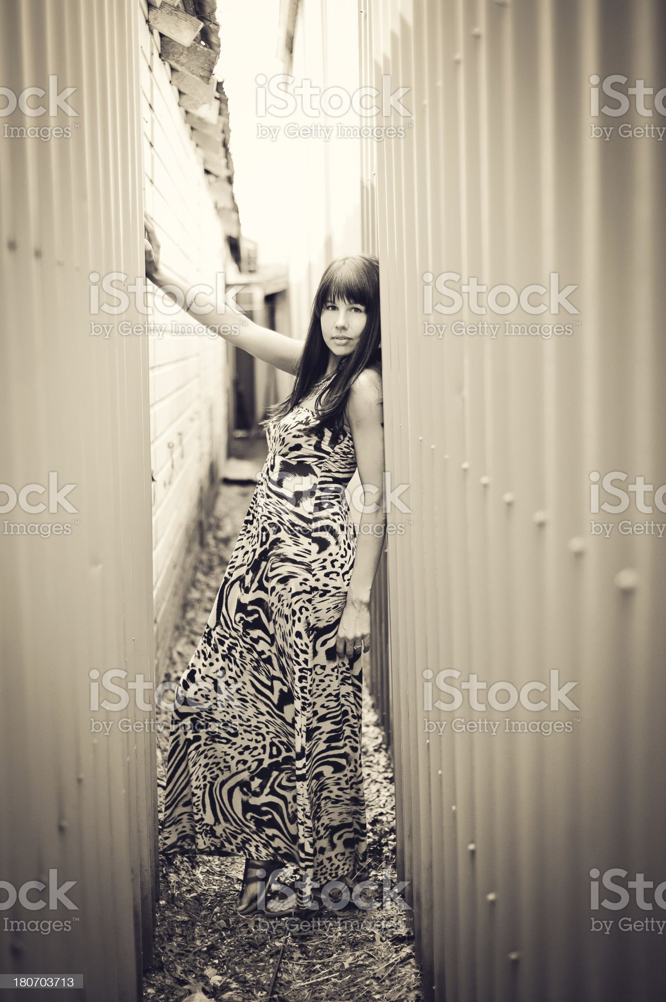 Beautiful woman in a narrow alley royalty-free stock photo