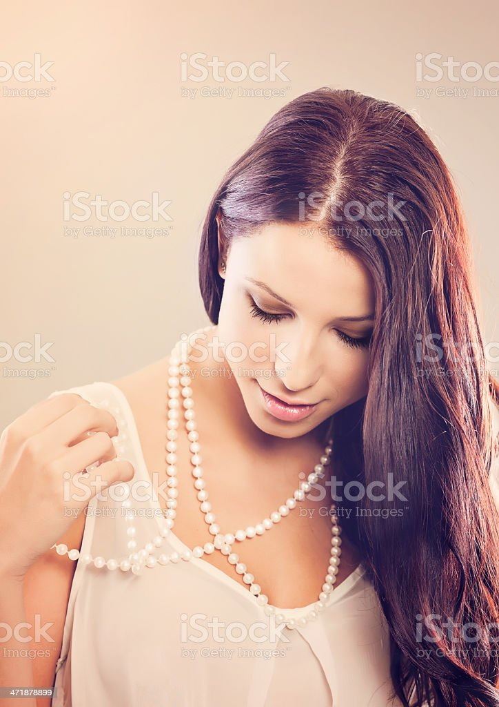 Beautiful woman in a pearl necklace royalty-free stock photo