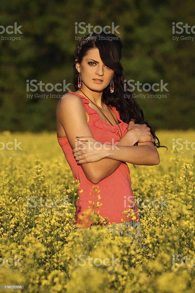 beautiful woman in a rapeseed field royalty-free stock photo