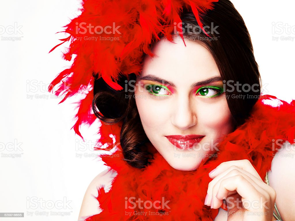 Beautiful woman in a red feather boa on white background stock photo