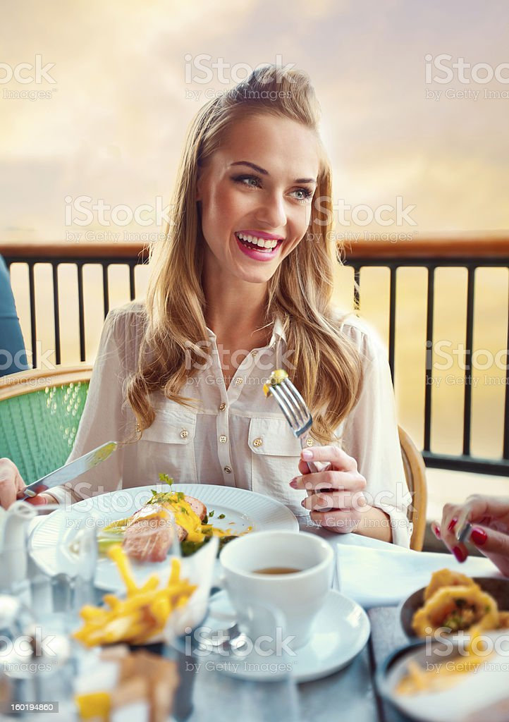 Beautiful Woman in a Restaurant royalty-free stock photo