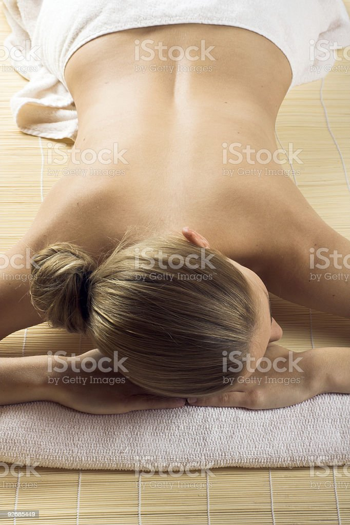 beautiful woman in a spa is relaxing royalty-free stock photo