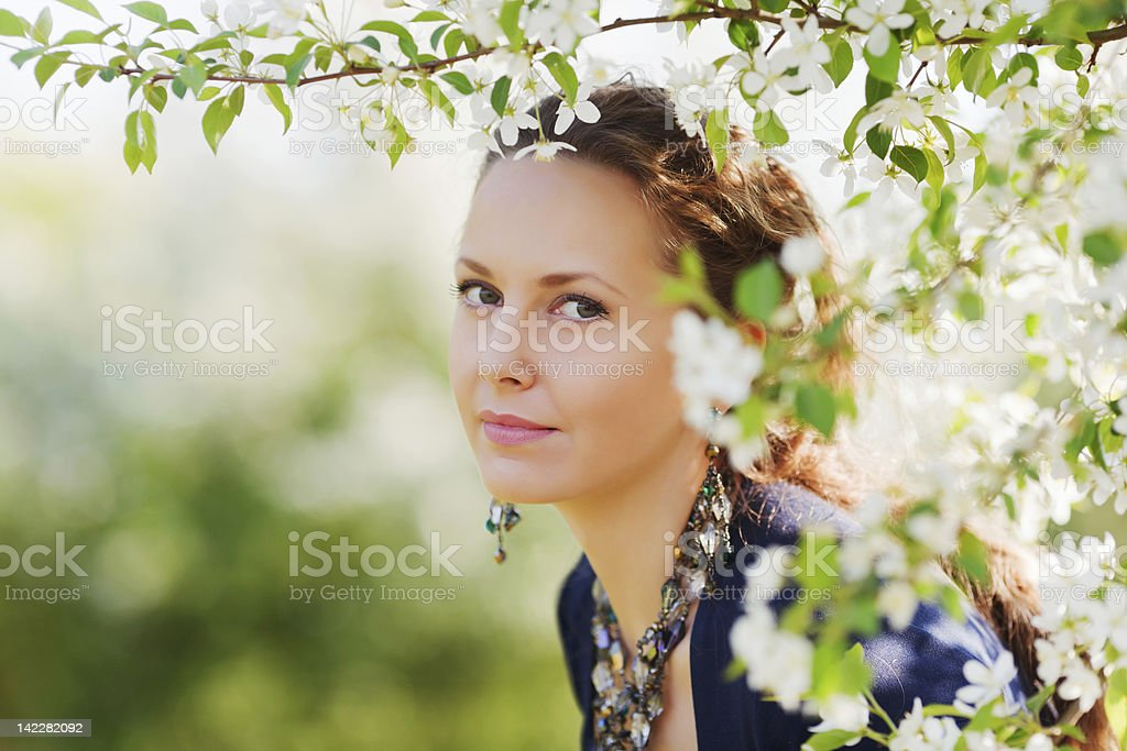 Beautiful woman in a spring garden royalty-free stock photo