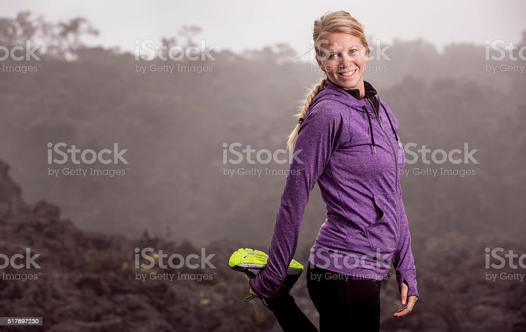 Beautiful Woman in a Stretching Pose stock photo