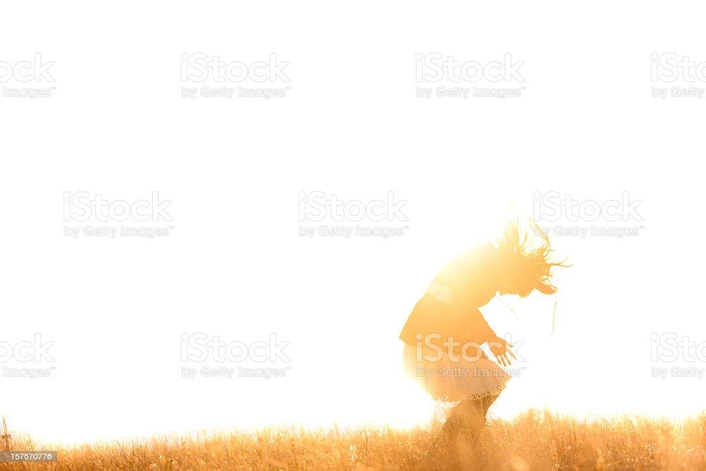 Beautiful woman in a sunlit field royalty-free stock photo