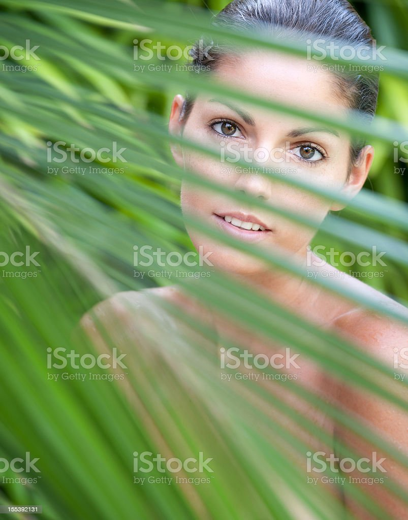 Beautiful woman in a tropical outdoor Spa royalty-free stock photo