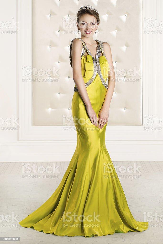 Beautiful woman in a yellow long dress stock photo