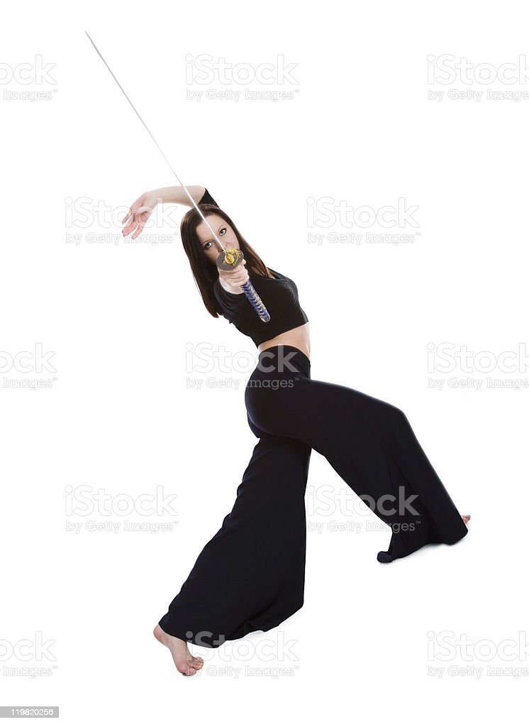 Beautiful woman in an aggressive posture with a sword  katana stock photo