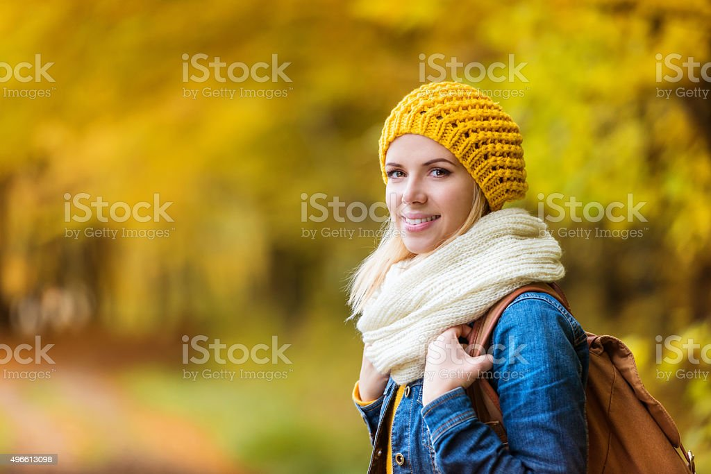 Beautiful woman in autumn nature stock photo