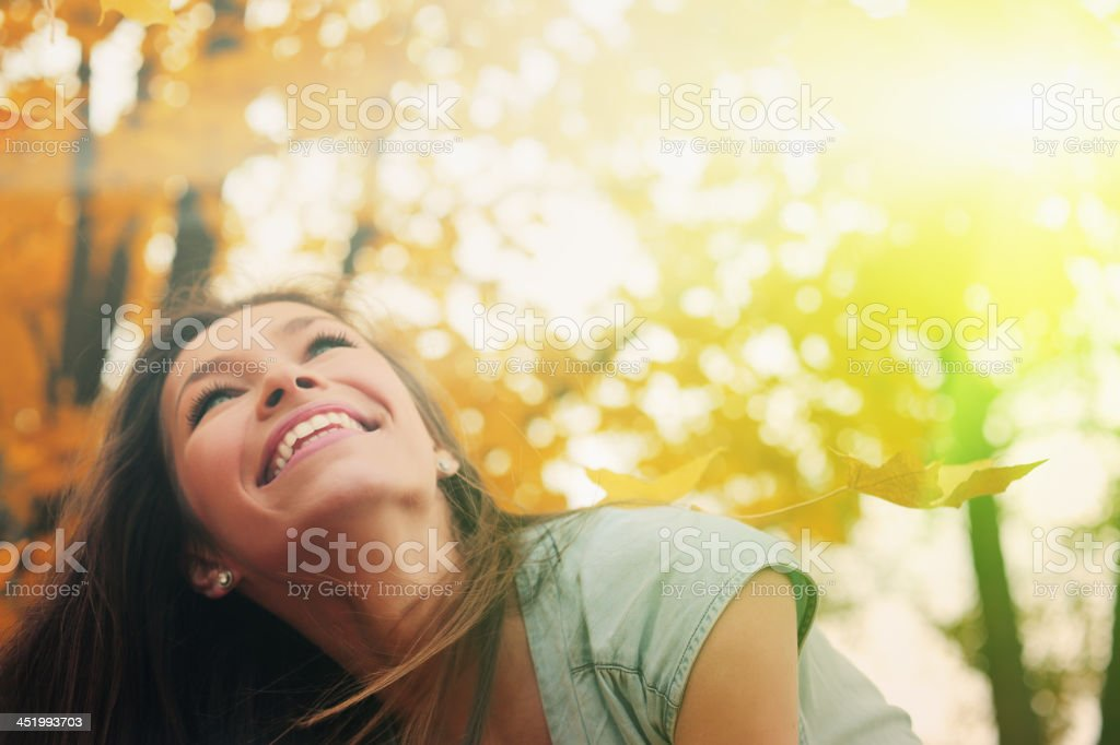 Beautiful woman in Autumn scenery stock photo