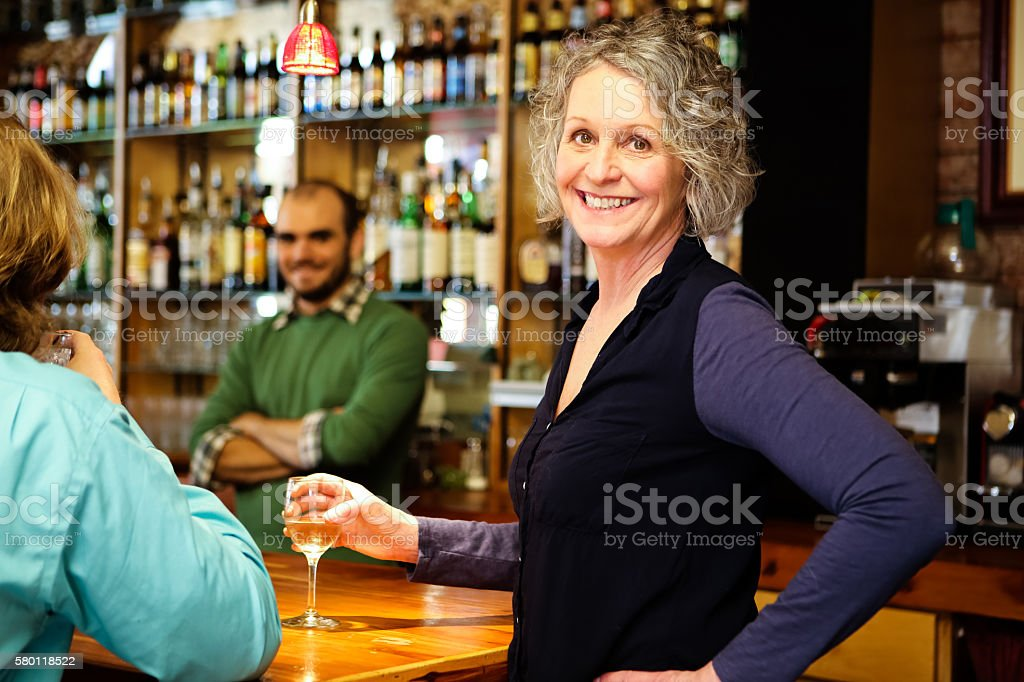 Beautiful Woman in Bar or Restaurant Smiling stock photo