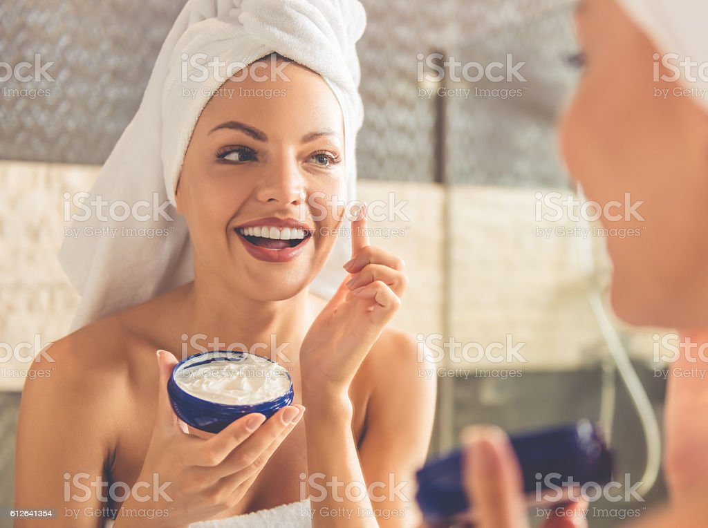 Beautiful woman in bathroom stock photo