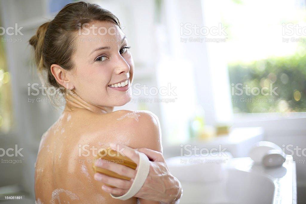 Beautiful woman in bathtub stock photo
