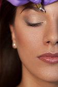 Beautiful woman in beauty slon on eyebrow makeup treatment