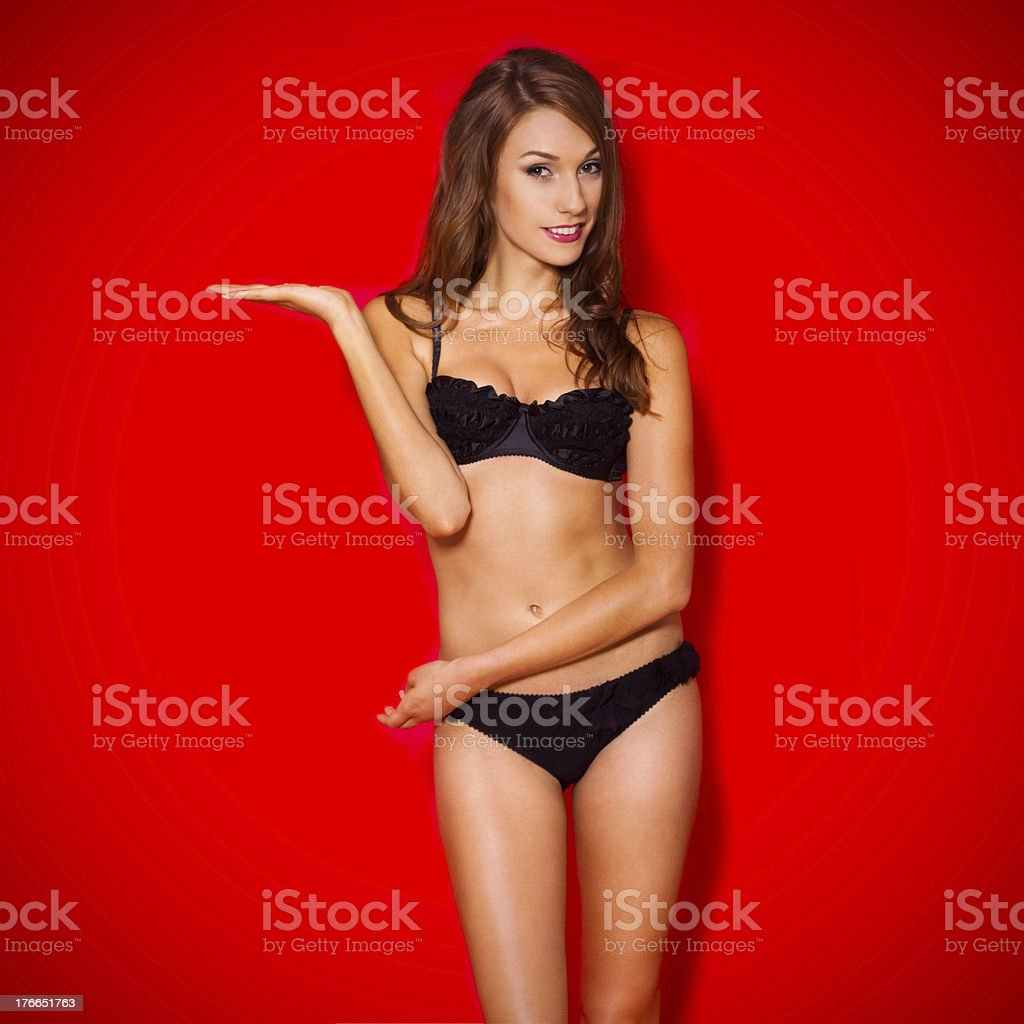 Beautiful Woman In Bikini Isolated on red Background. royalty-free stock photo