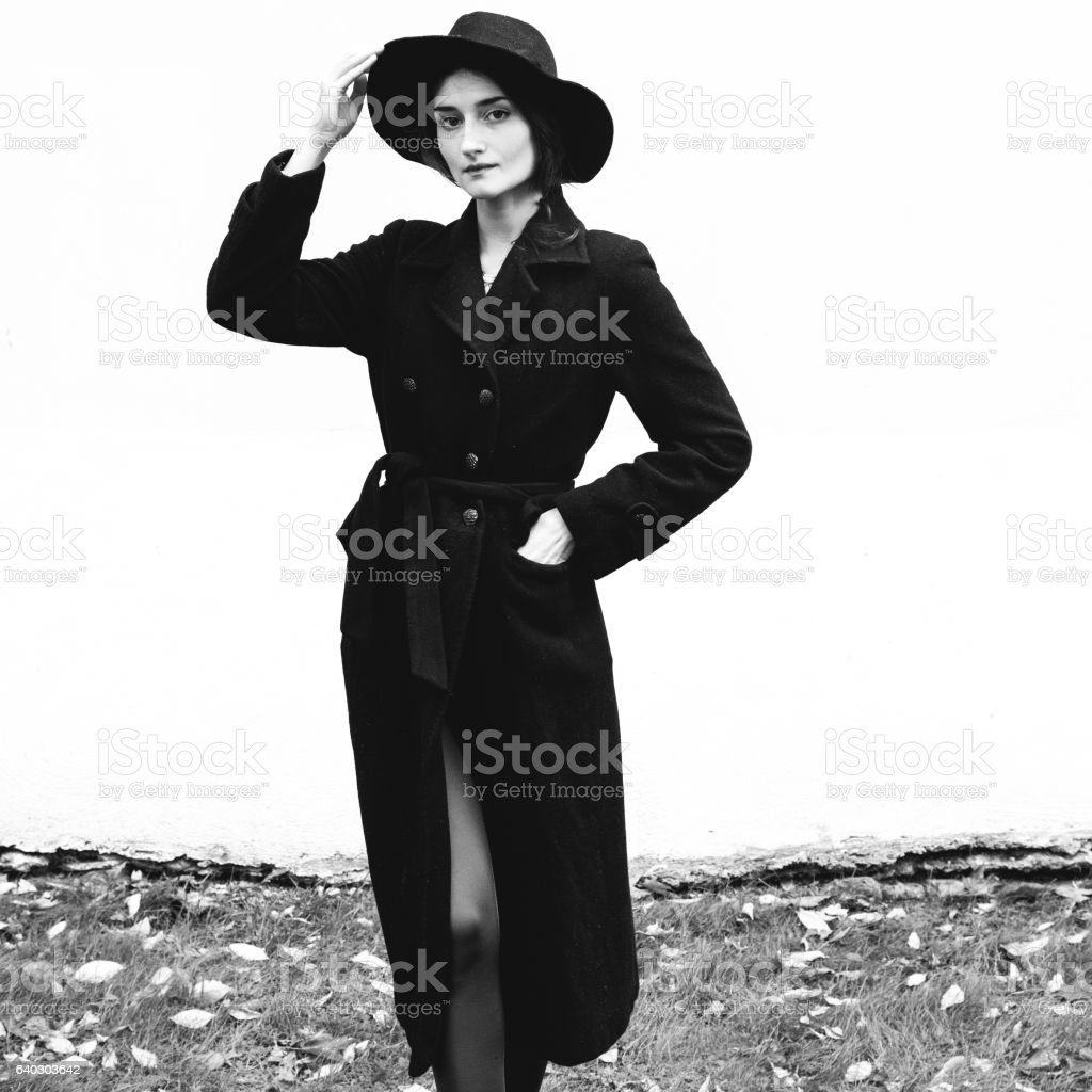 Beautiful woman in black coat street portrait fashion. Black white. stock photo