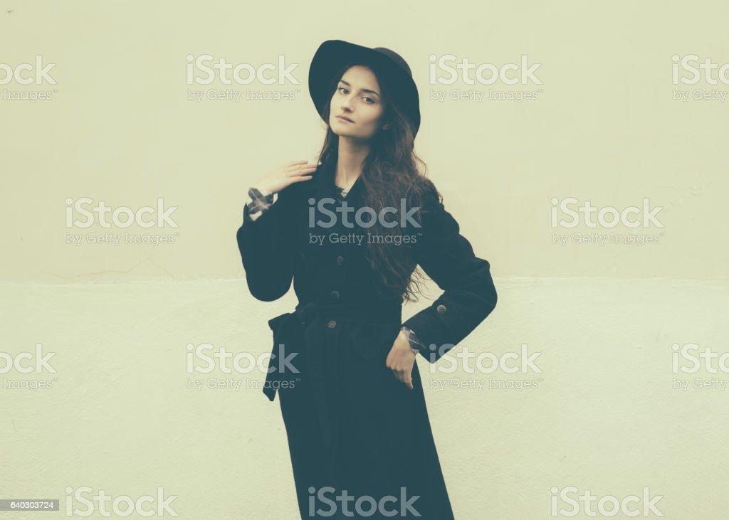 Beautiful woman in black coat street portrait fashion. stock photo