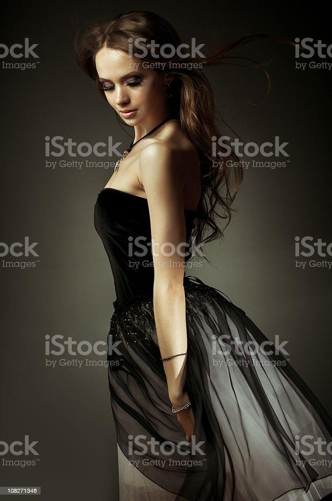 Beautiful woman in black dress royalty-free stock photo