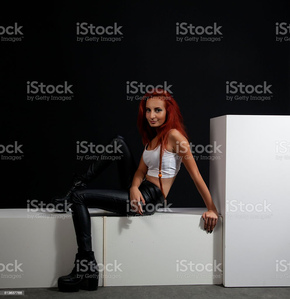 Beautiful woman in black leather pants stock photo
