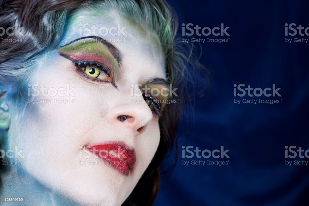Beautiful Woman in Blue Body Paint royalty-free stock photo