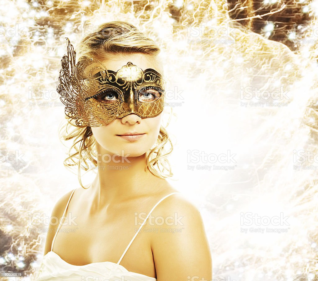 Beautiful woman in carnival mask over abstract background stock photo
