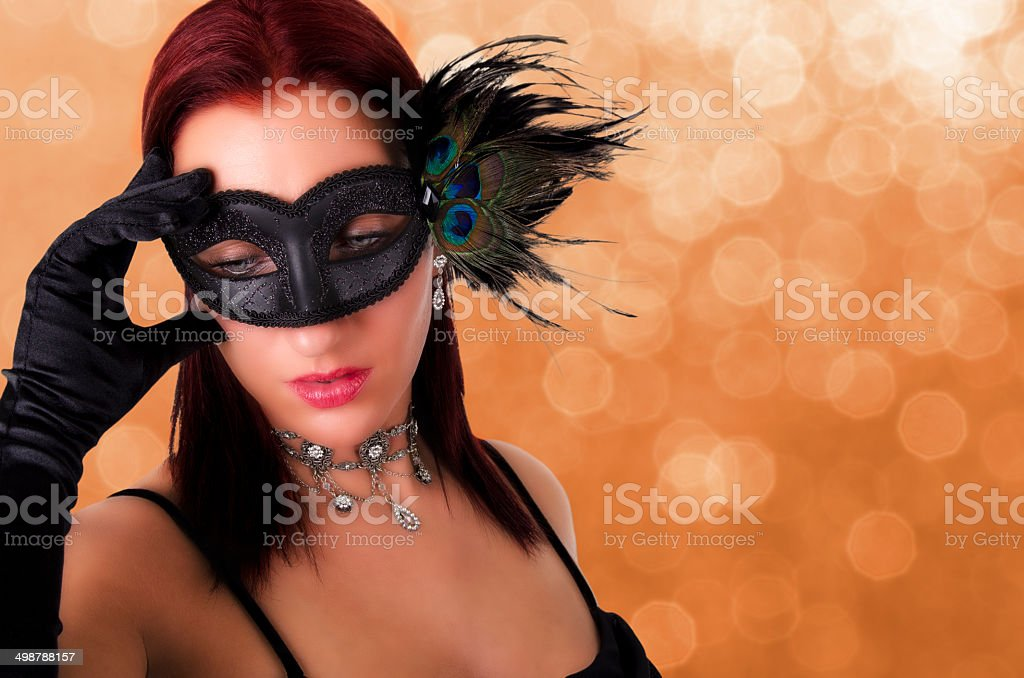 Beautiful woman in carnival mask. stock photo