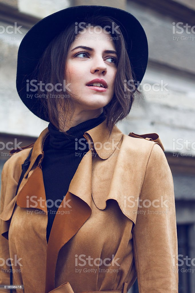 Beautiful woman in coat stock photo