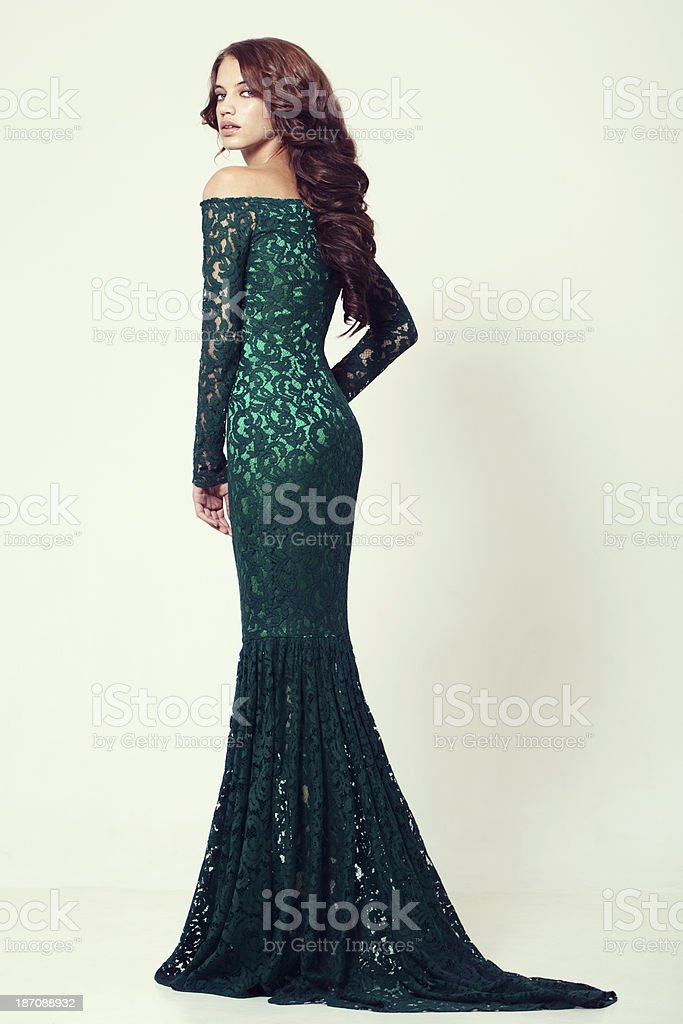 Beautiful woman in cocktail dress stock photo