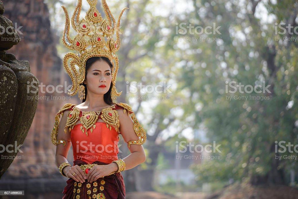 A beautiful woman in dancer apsara costume at stone stock photo