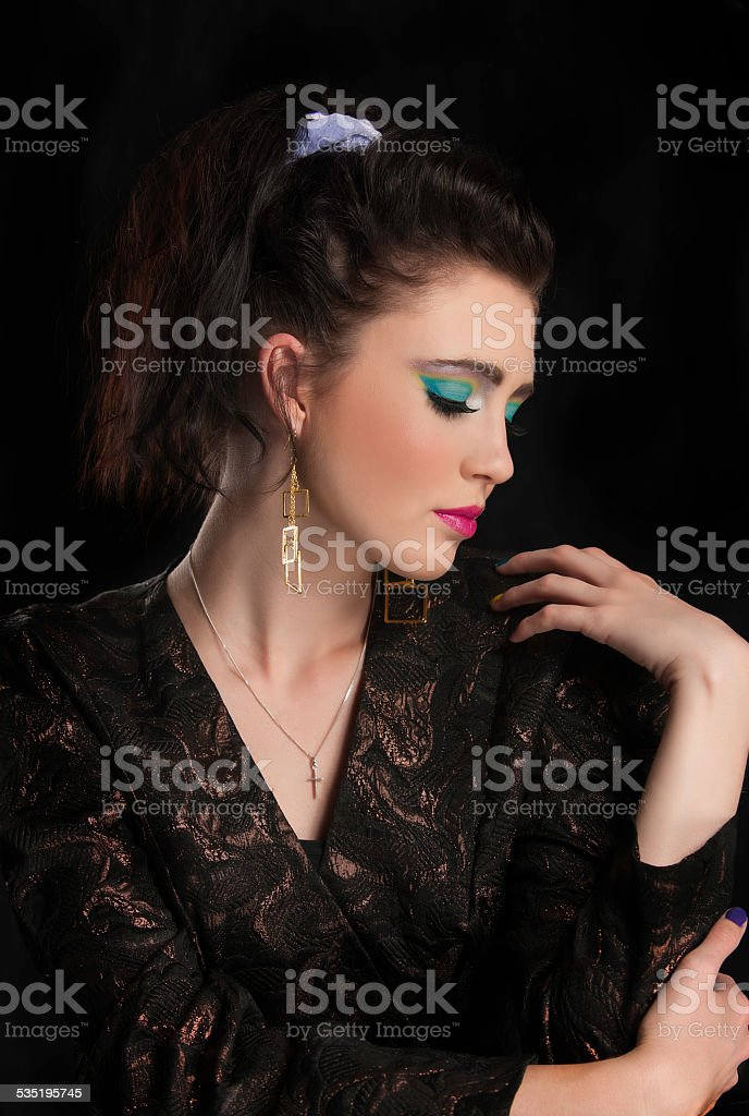 Beautiful woman in eighties makeup and clothing stock photo