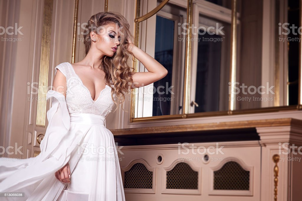 Beautiful woman in elegant dress. stock photo