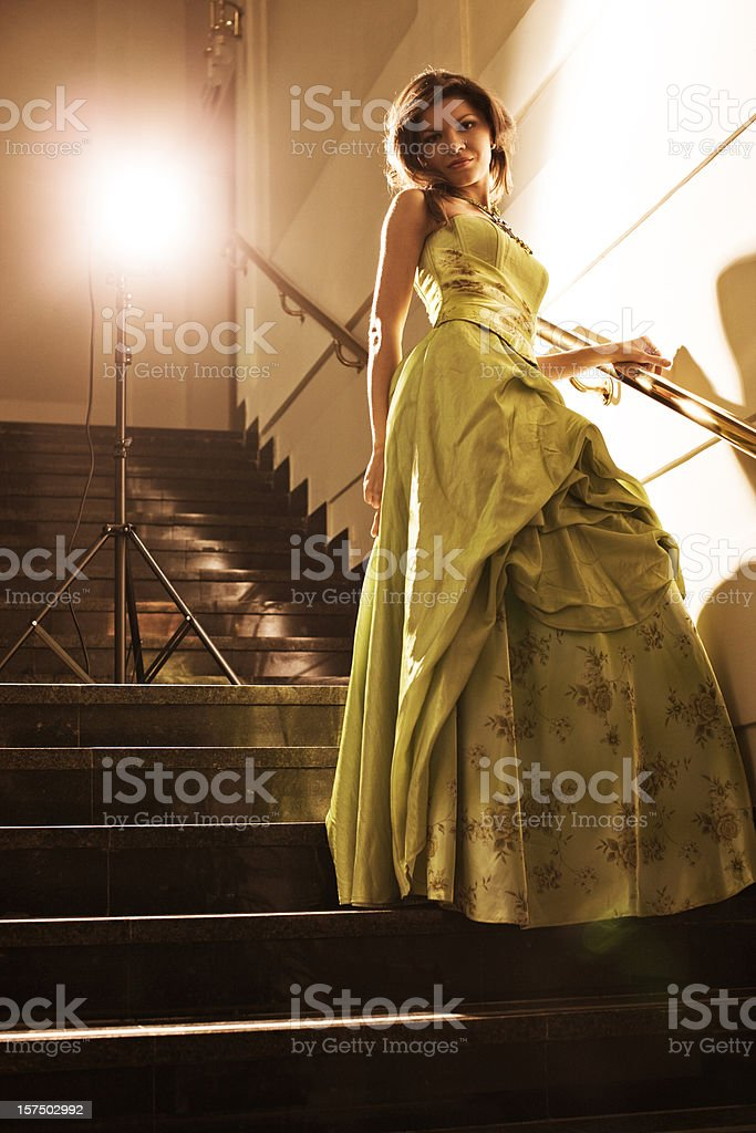 Beautiful Woman in evening dress on stairs royalty-free stock photo