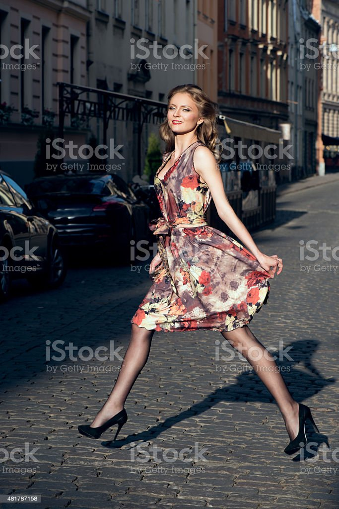 Beautiful woman in floral dress stock photo