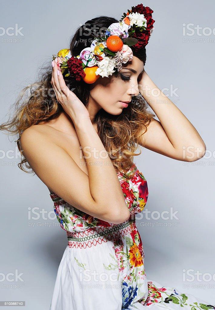 Beautiful woman in flower crown stock photo
