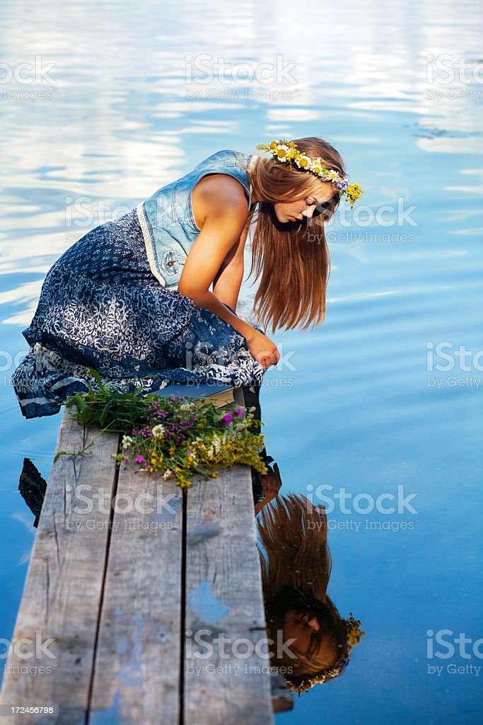 beautiful woman in flower wreath royalty-free stock photo