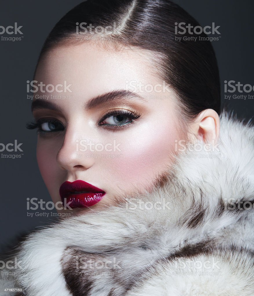 Beautiful woman in fur coat stock photo