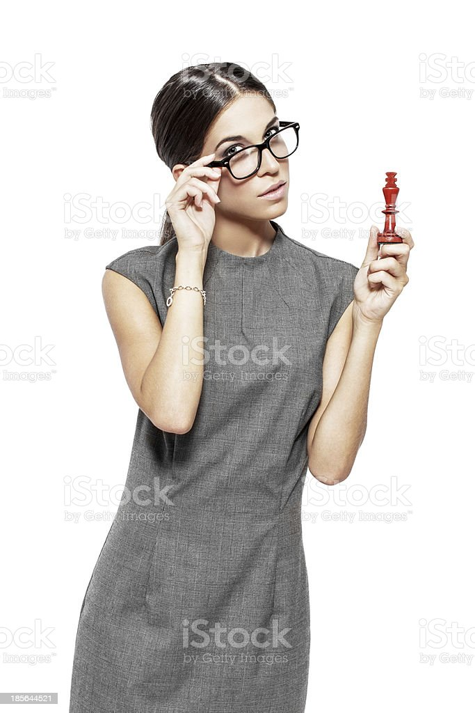 Beautiful woman in glasses holding king royalty-free stock photo