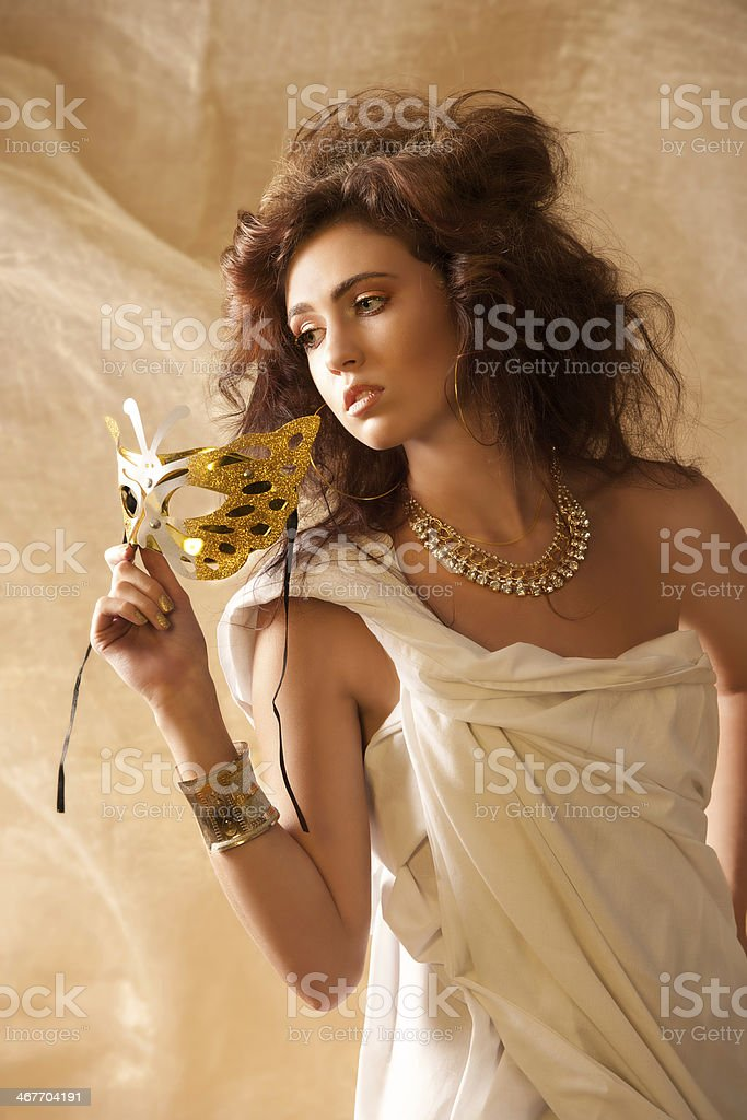 Beautiful woman in goddess clothes with mask stock photo