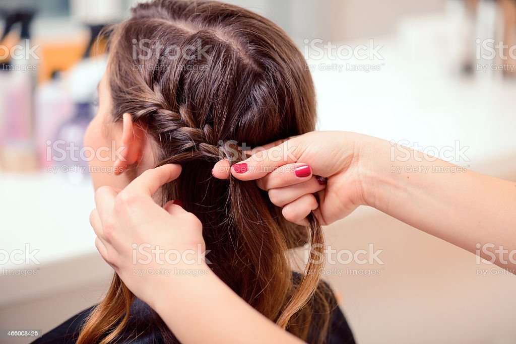 Beautiful woman in hair salon stock photo