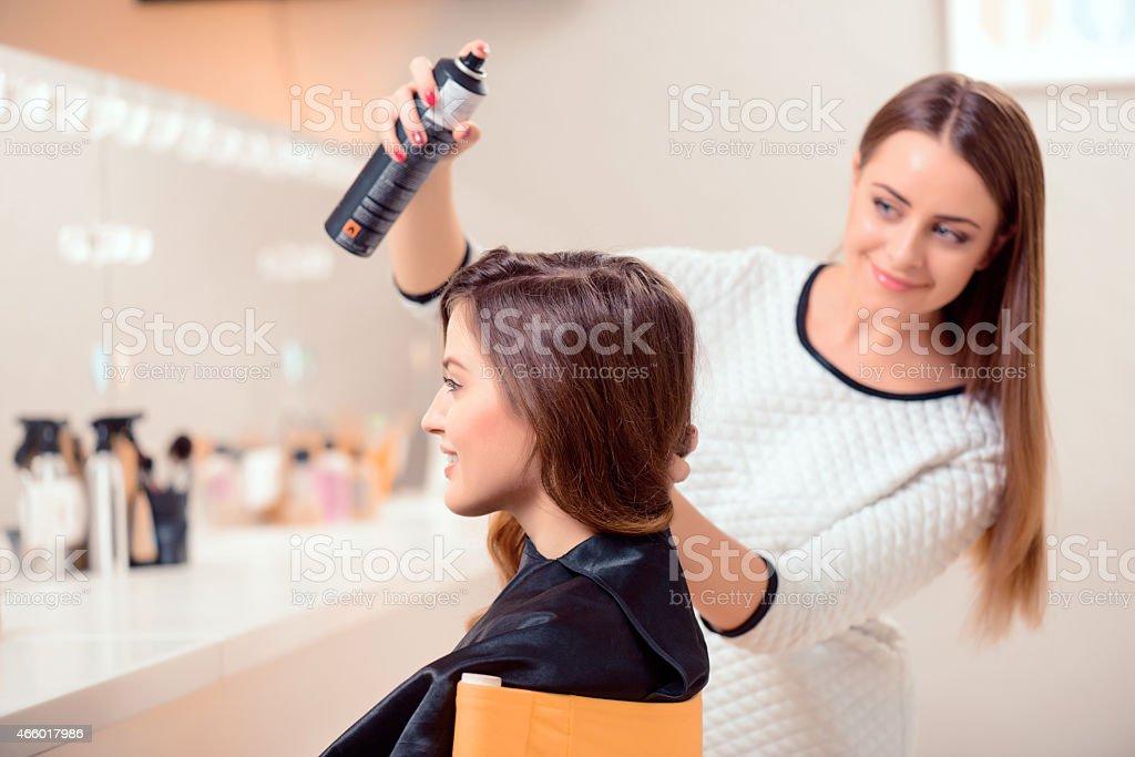 Beautiful woman in hair salon stock photo