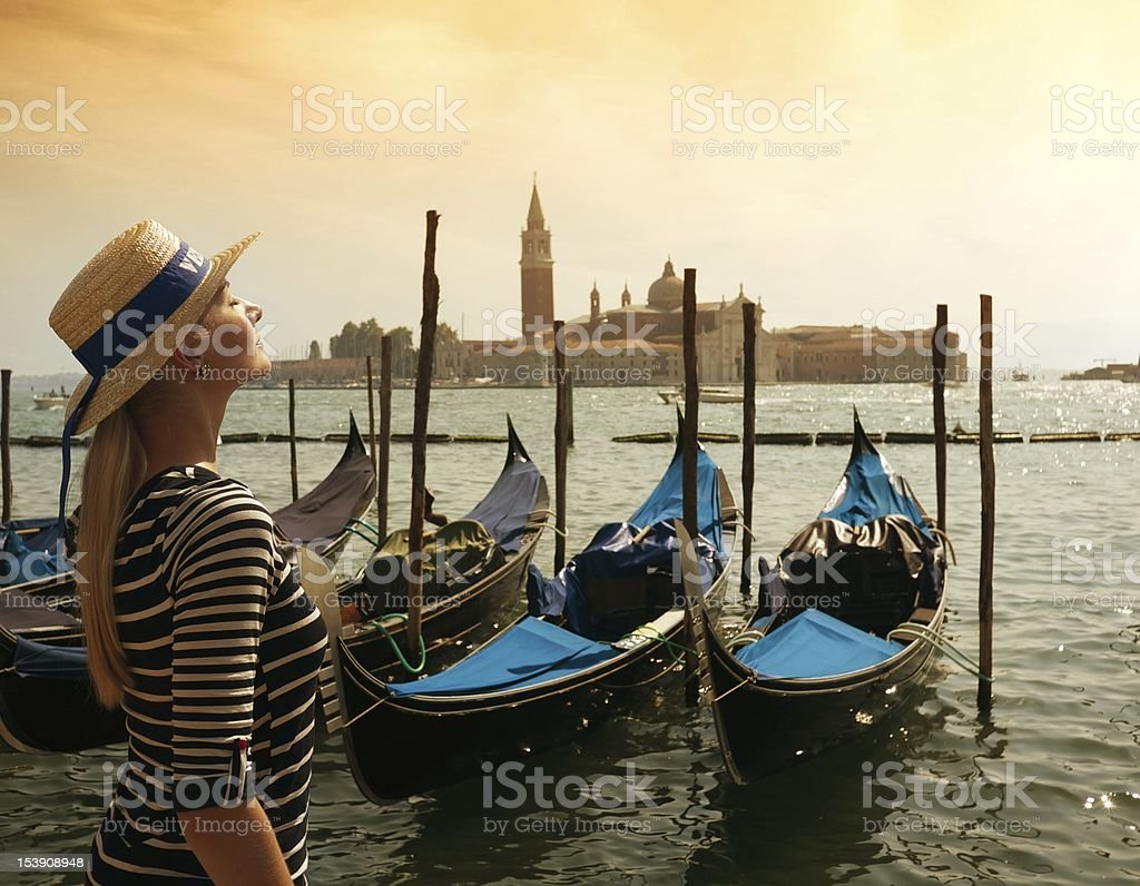 Beautiful woman in hat against Venice panorama royalty-free stock photo