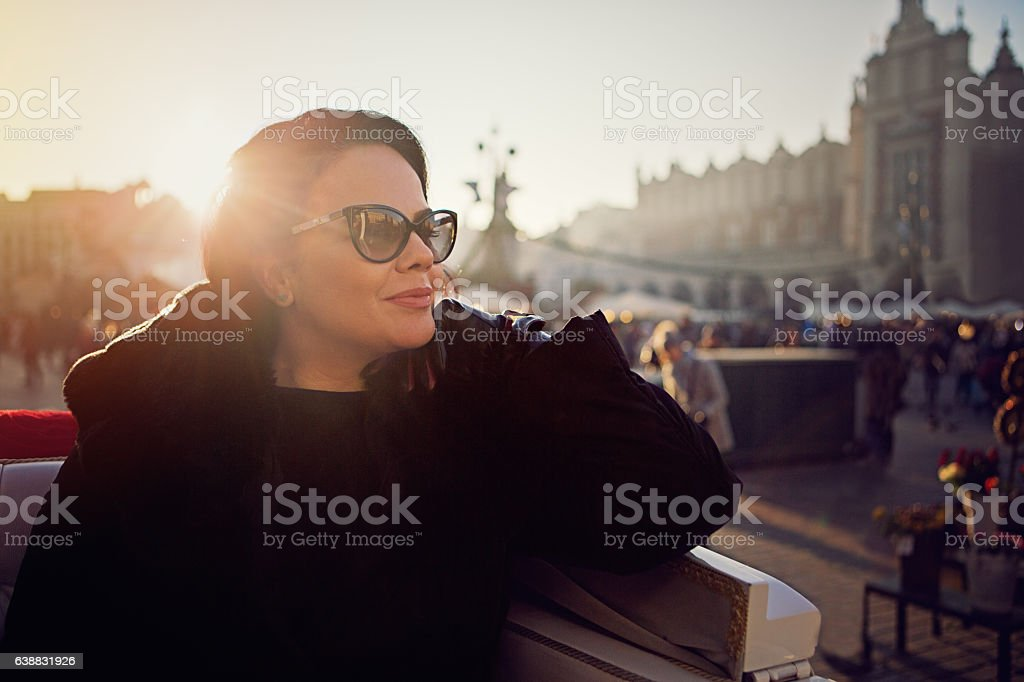 Beautiful woman in horse carriage stock photo