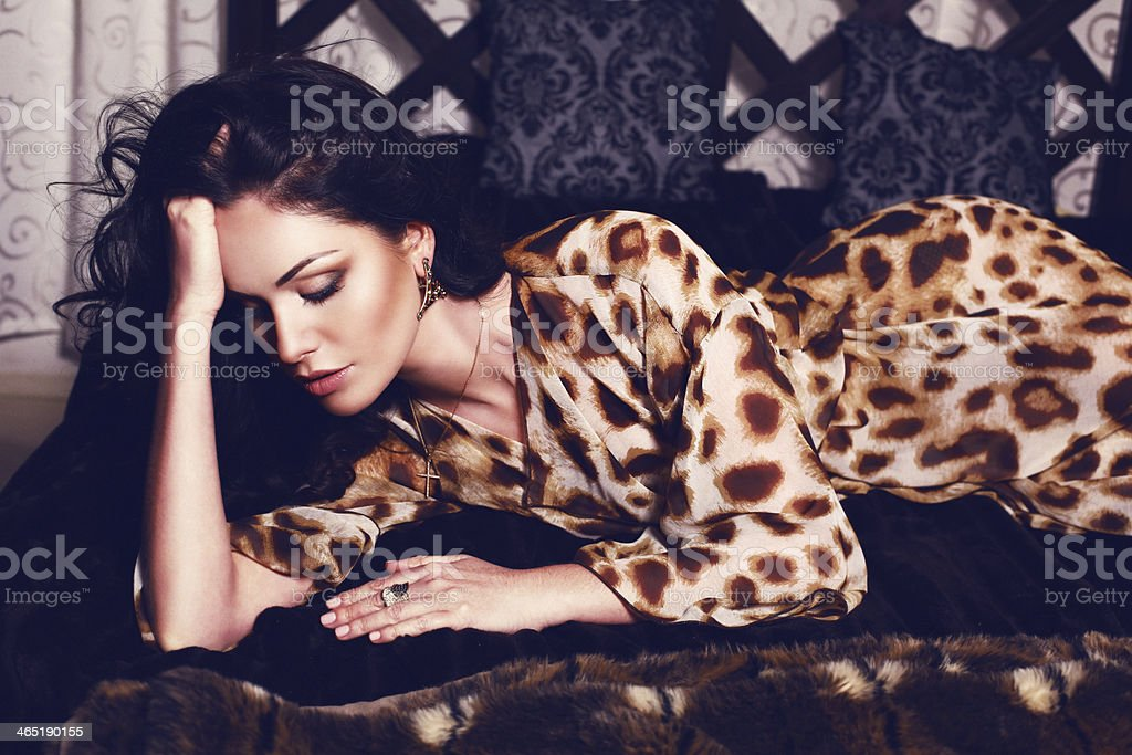 beautiful woman in leopard print dress stock photo